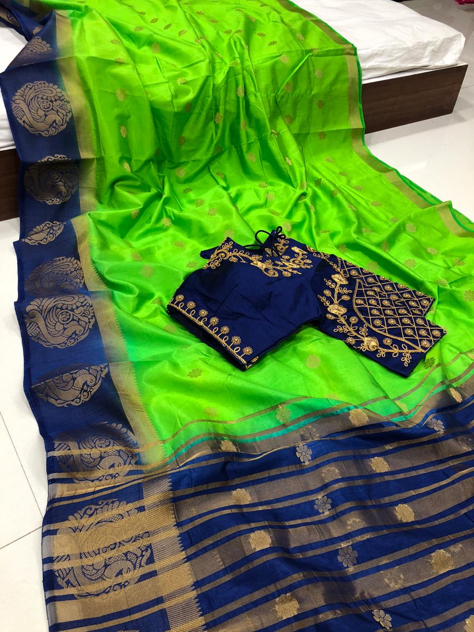 Good looking Green Color Fancy Mutli Thread Kanjivaram Butti Full Stitched Blouse Raw Silk Saree For Function Wear