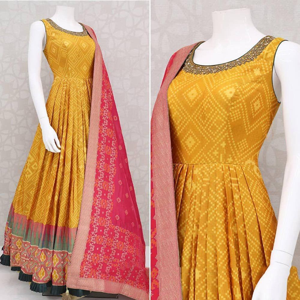 Astonishing Mustard Color Festive Wear Soft Butter Crape Silk Patola Printed Designer Full Stitched Gown