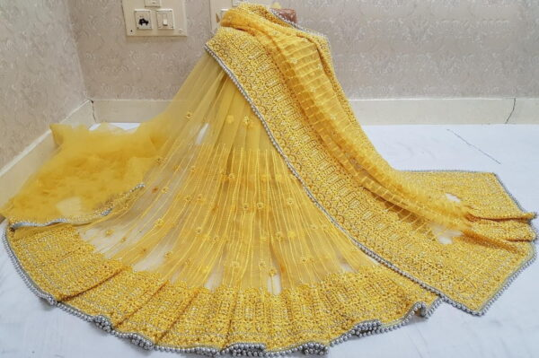 Remarkable Yellow Color Fancy LCD Stone Embroidered Steel Hand Pandadi Jarkhan Work Net Saree Blouse For Wedding Wear